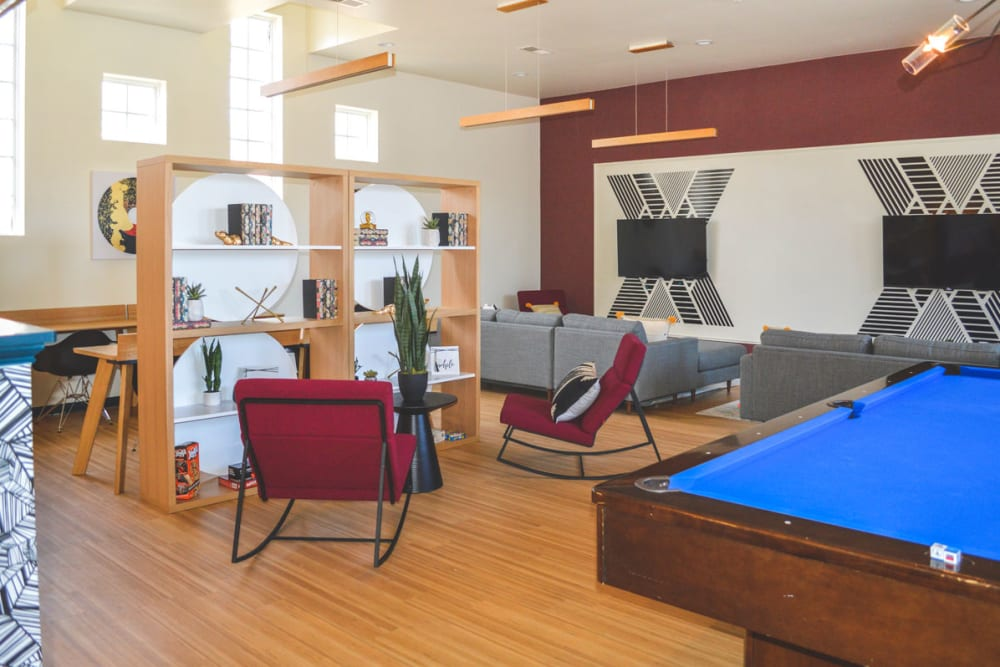 Clubhouse and pool table at Sunchase Apartments in Greenville, North Carolina