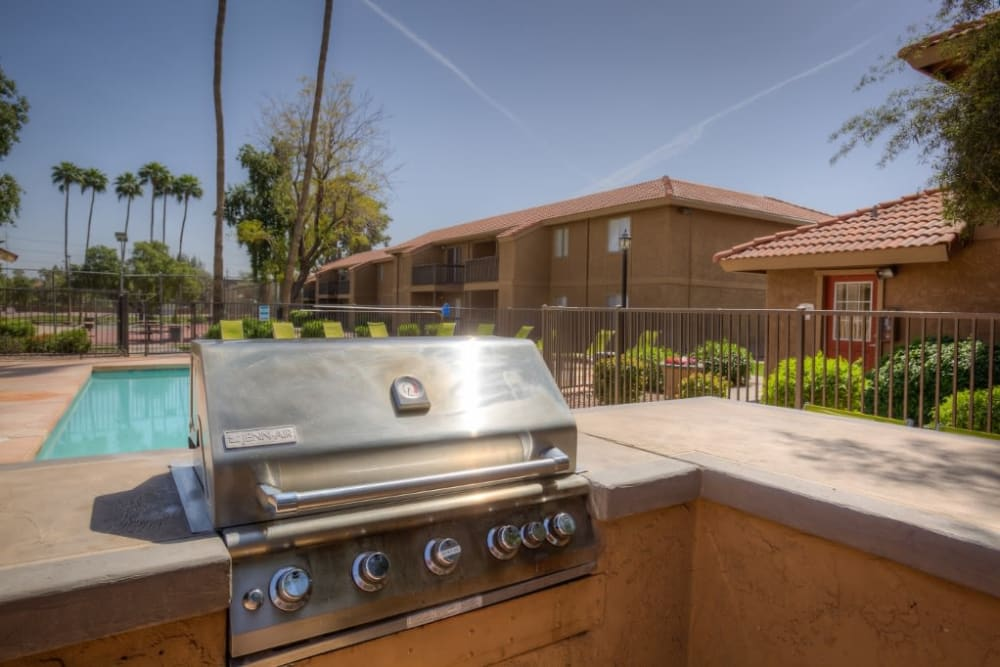 Outdoor grilling station by community pool at 505 West Apartment Homes in Tempe, Arizona
