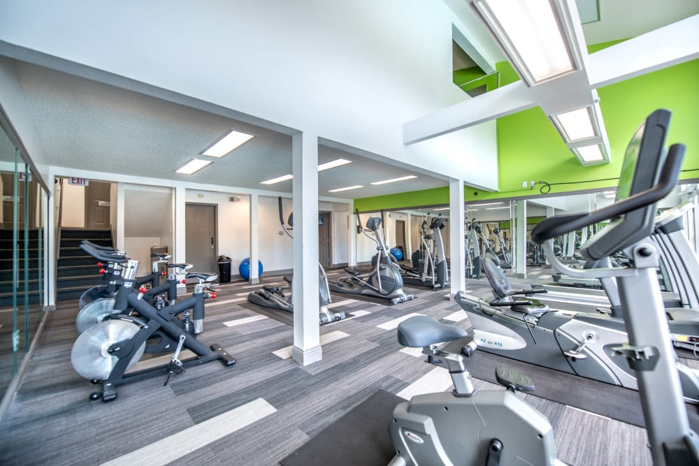 Modern fitness equipment in fitness center at 8500 Harwood Apartment Homes in North Richland Hills, Texas
