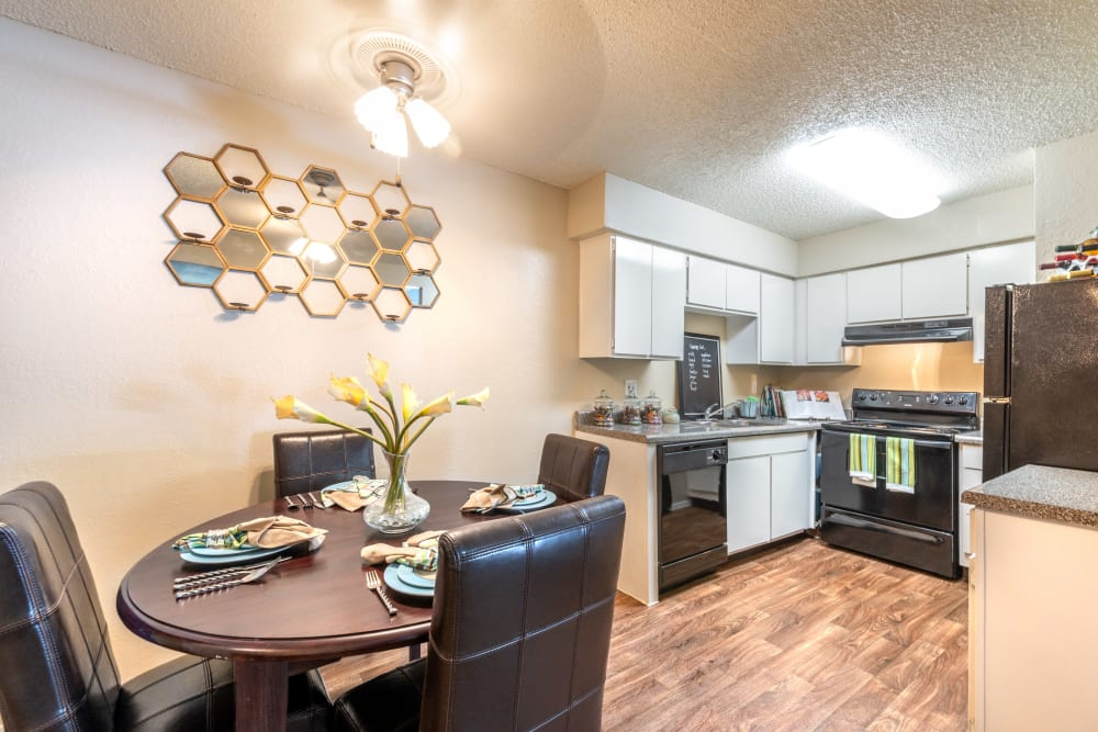 Dining space and kitchen at 8500 Harwood Apartment Homes in North Richland Hills, Texas