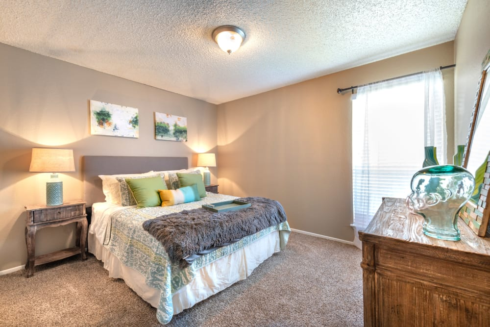 Spacious and well lit bedroom at 8500 Harwood Apartment Homes in North Richland Hills, Texas