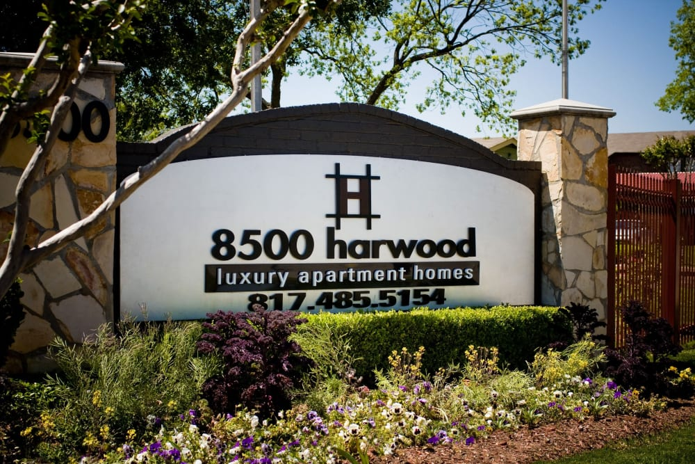 Community sign at entrance to 8500 Harwood Apartment Homes in North Richland Hills, Texas