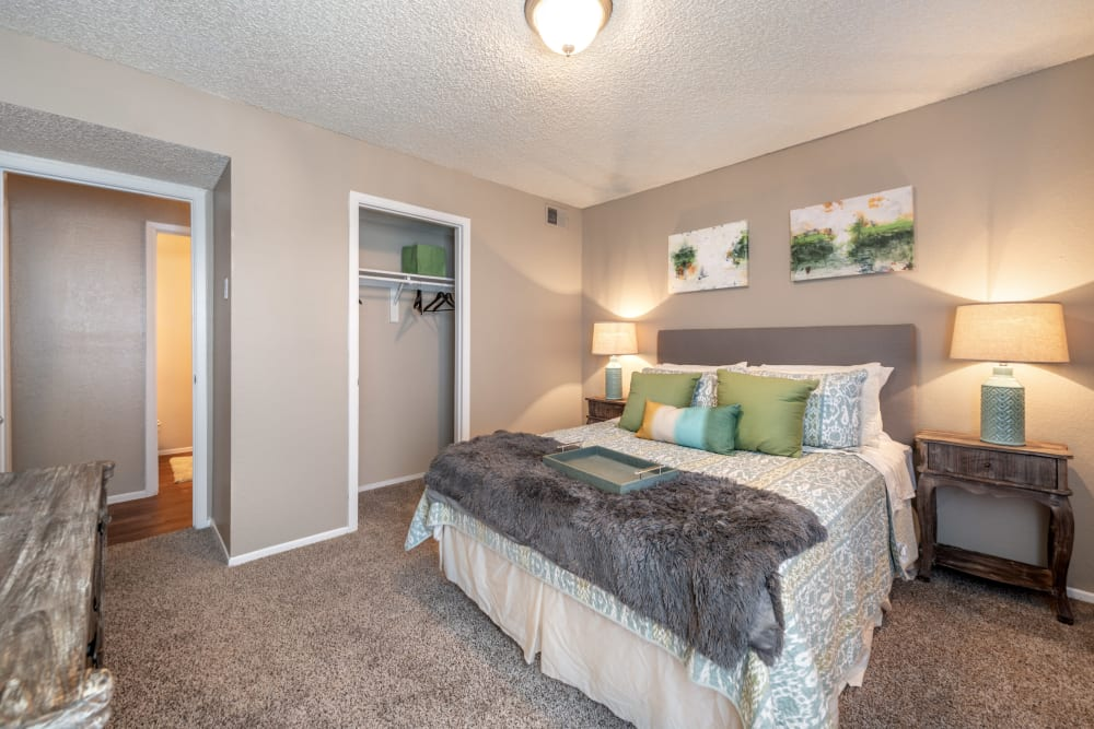 Spacious bedroom with well appointed decor at 8500 Harwood Apartment Homes in North Richland Hills, Texas