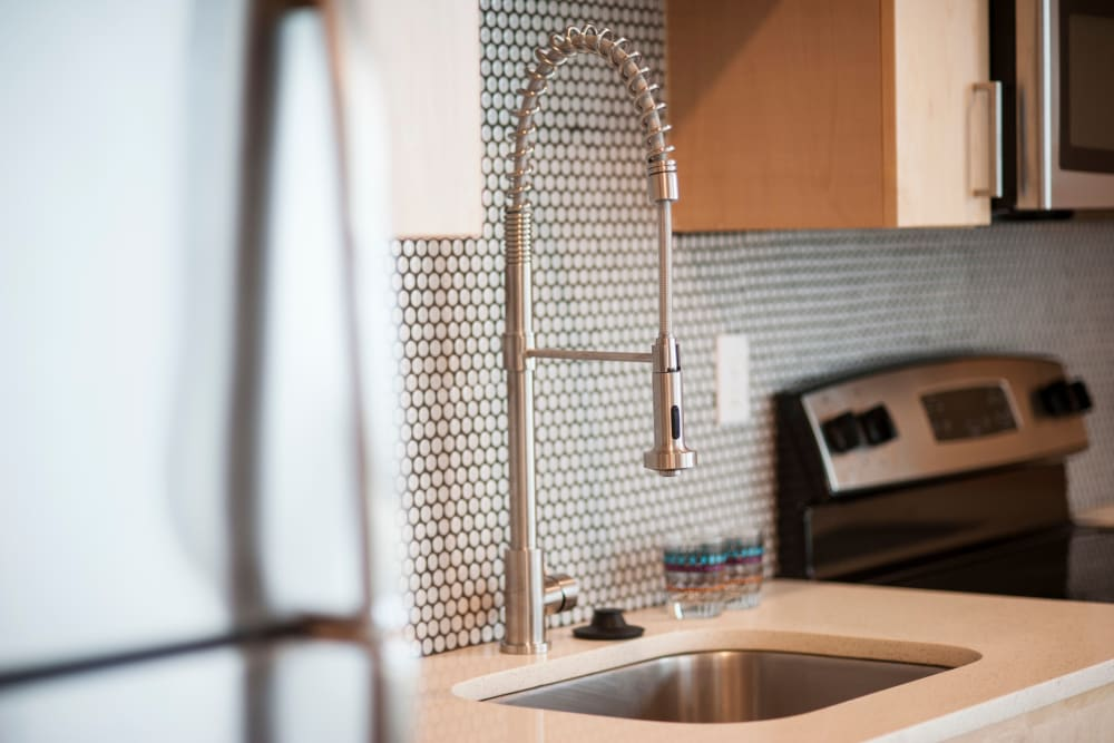 Custom tile backsplash and modern fixtures in a model home's kitchen at Brooklyn Yard in Portland, Oregon