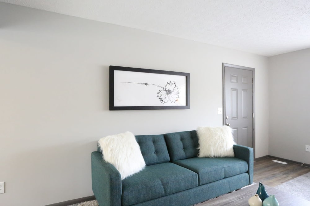Model living room with blue couch at Worthington Meadows in Columbus, Ohio