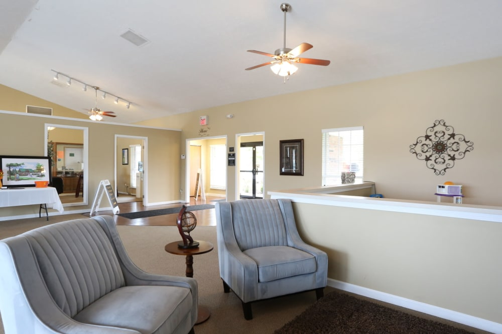Gray accent chairs in model living room at Worthington Meadows in Columbus, Ohio