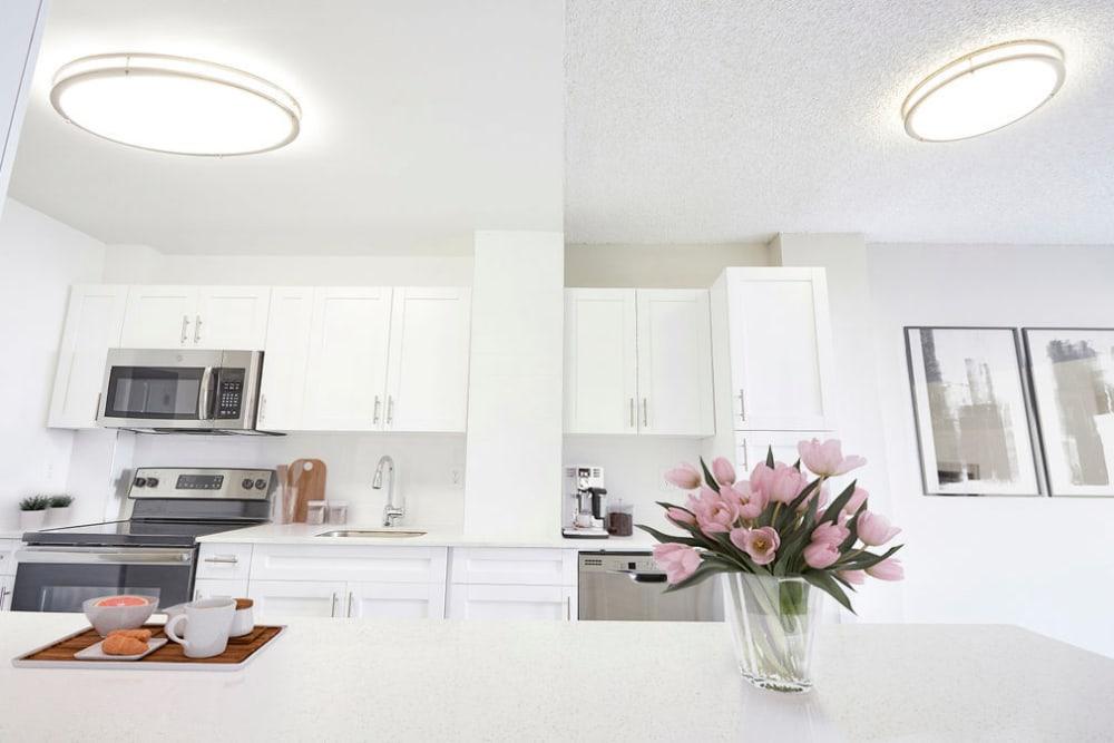 A large white apartment kitchen at Aliro in North Miami Beach, Florida
