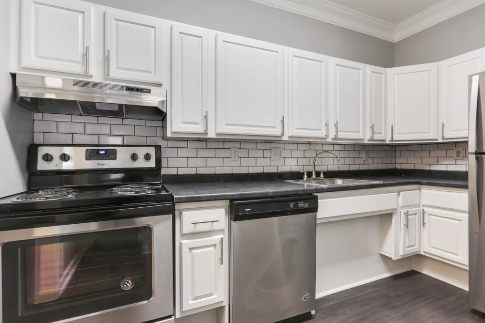 An apartment kitchen with new appliances at Crest at East Cobb in Marietta, Georgia