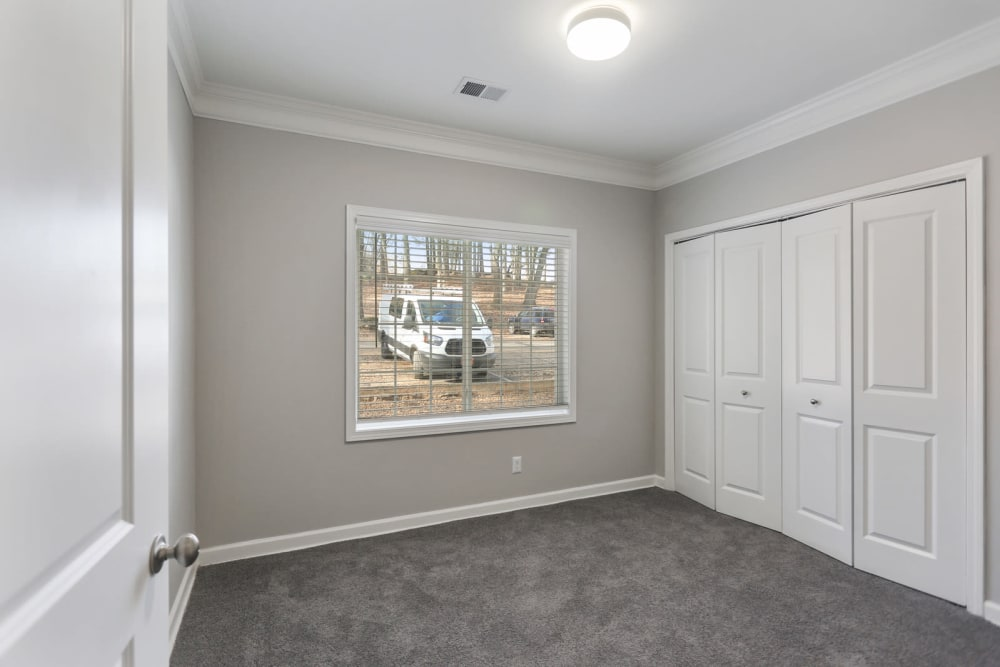 A large apartment bedroom with closet at Crest at East Cobb in Marietta, Georgia