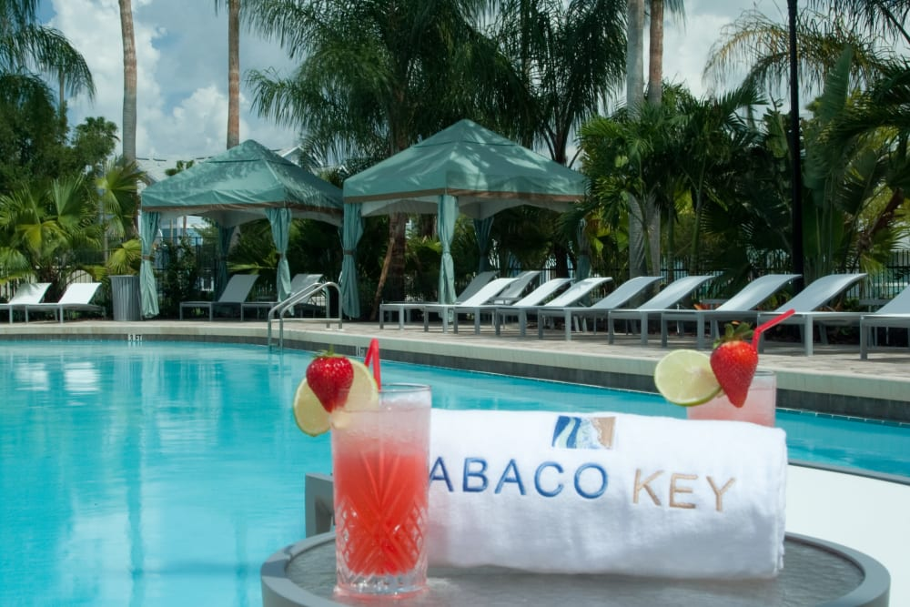 Drinks and lounge seating by Swimming Pool at Abaco Key in Orlando, Florida