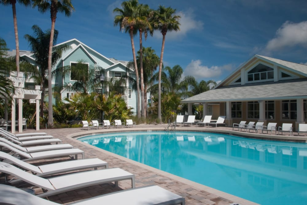 Luxury Swimming Pool with lunge chair seating at Apartments in Orlando, Florida