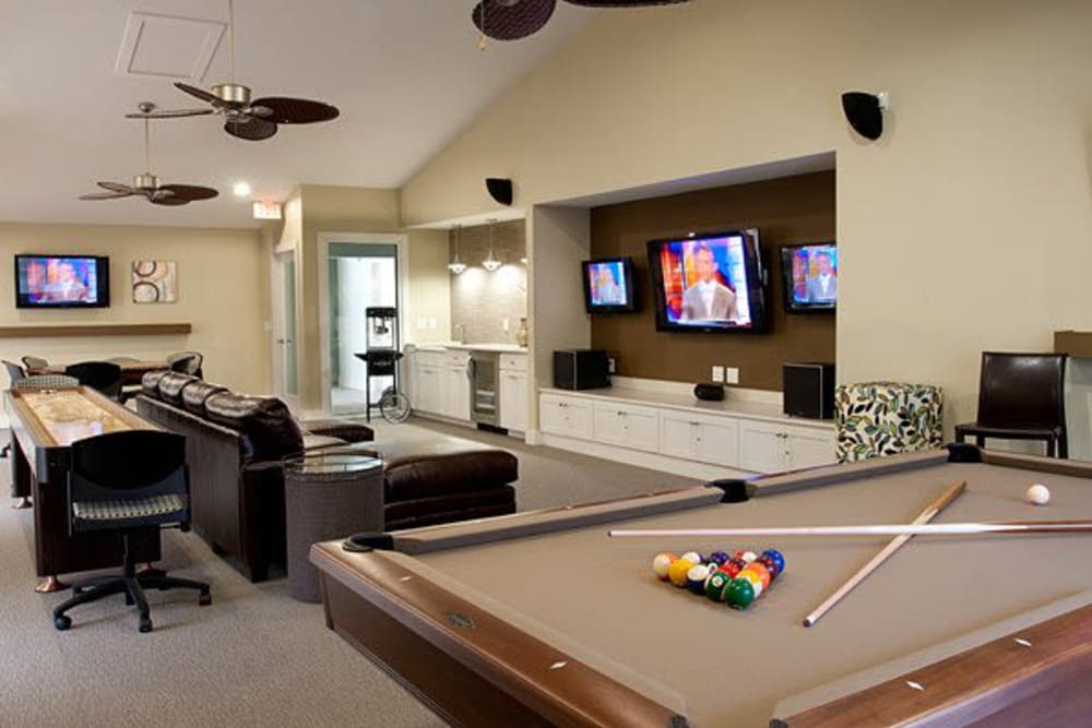 Clubhouse featuring a billiards table and other games at Apartments in Orlando, Florida