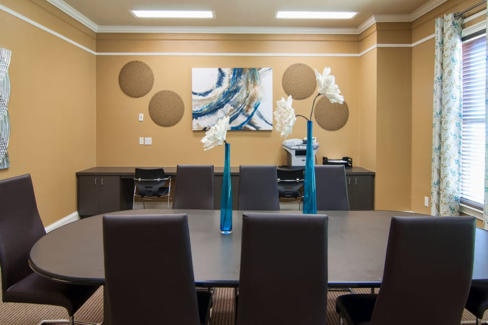 Conference table in brightly painted meeting space at Amber Chase Apartment Homes in McDonough, Georgia