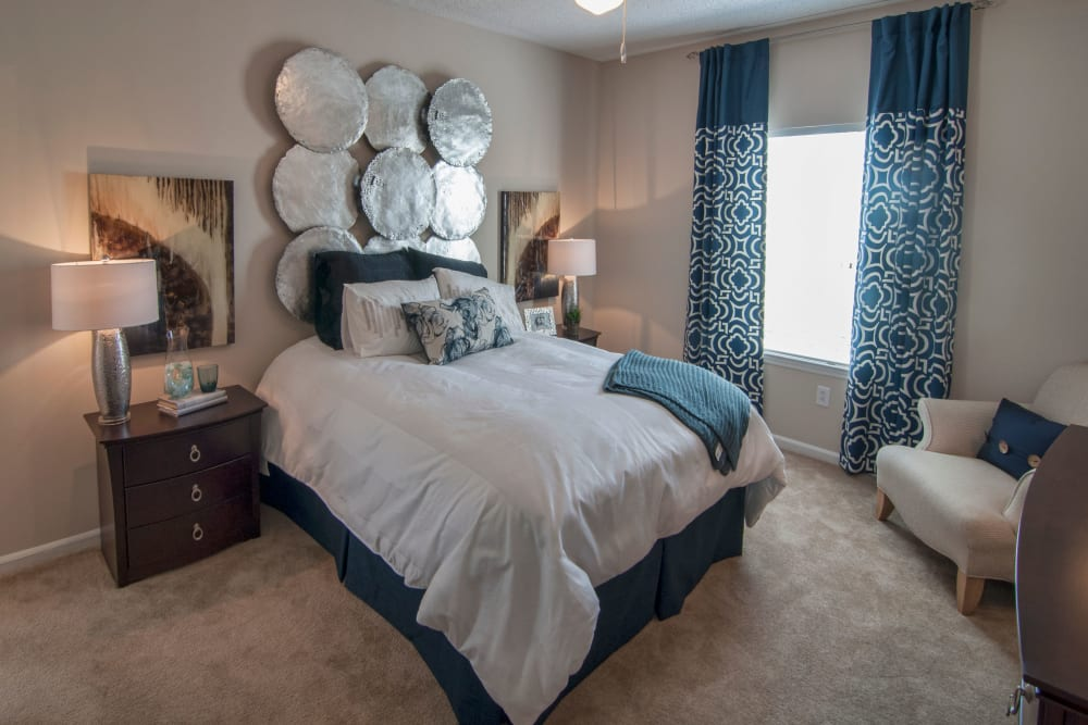 Well decorated and naturally lit Bedroom at Amber Chase Apartment Homes in McDonough, Georgia