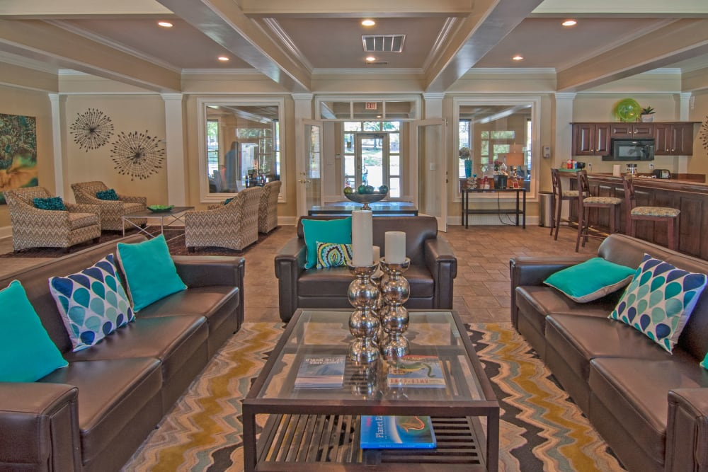 Enjoy Apartments with beautiful community seating areas in the Clubhouse at Amber Chase Apartment Homes