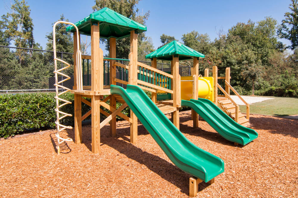 Children's playground facility and green space at Amber Chase Apartment Homes in McDonough, Georgia