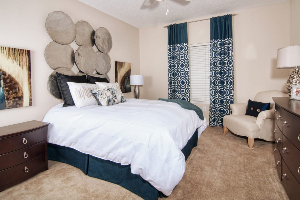 Comfortable and spacious bedroom located at Amber Chase Apartment Homes in McDonough, Georgia