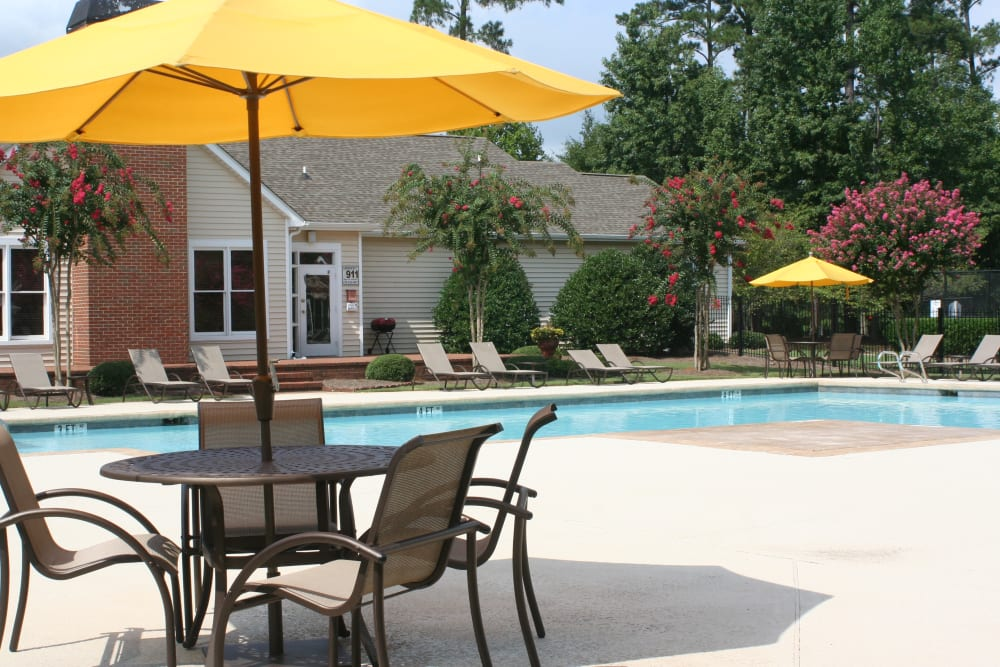 Poolside seating at Amber Chase Apartment Homes in McDonough, Georgia