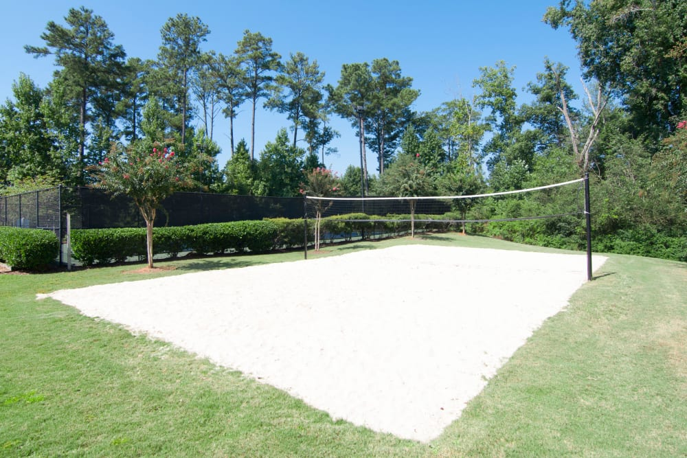 Sand volleyball court and green space at Amber Chase Apartment Homes in McDonough, Georgia