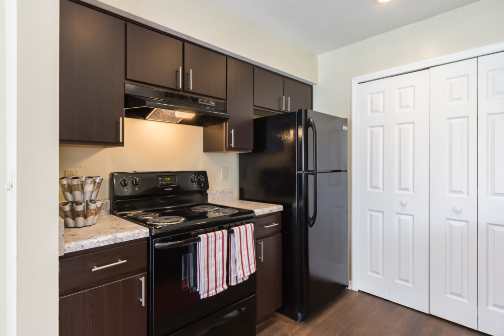 Modern kitchen featuring ample storage and black appliances at Alexander Court in Reynoldsburg, Ohio