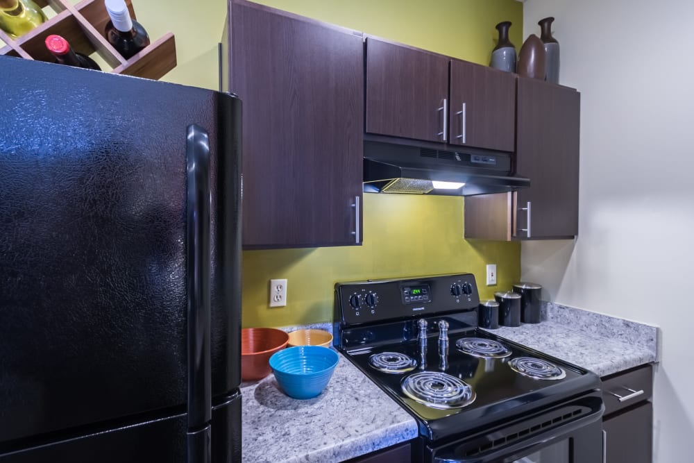 Black appliances featured in this modern kitchen at Alexander Court in Reynoldsburg, Ohio