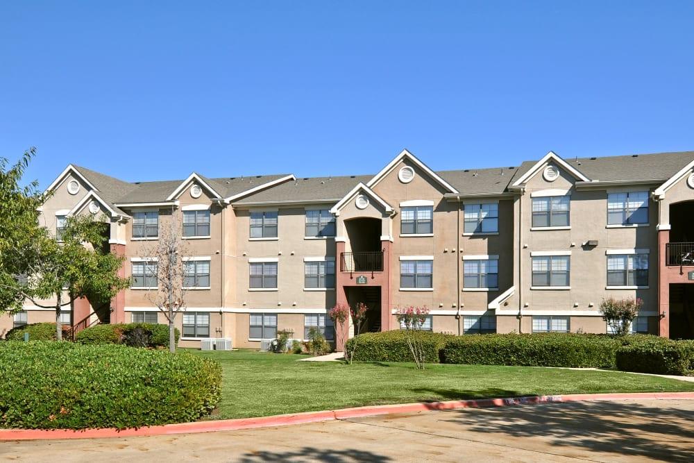 Exterior of apartment building at Arbrook Park Apartment Homes in Arlington, Texas
