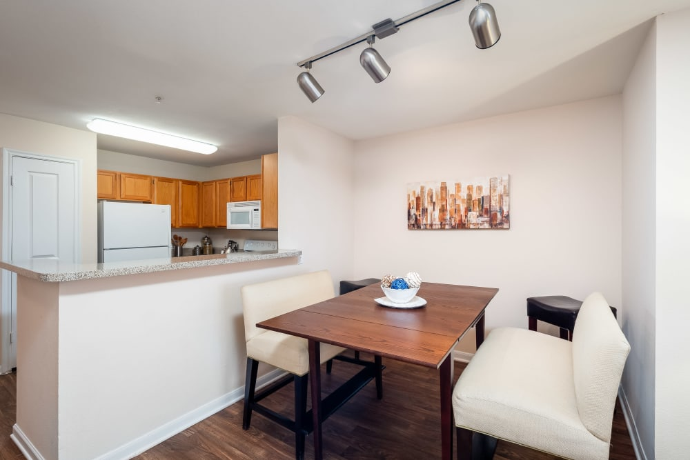Dining space outside of kitchen in model home at Arbrook Park Apartment Homes in Arlington, Texas