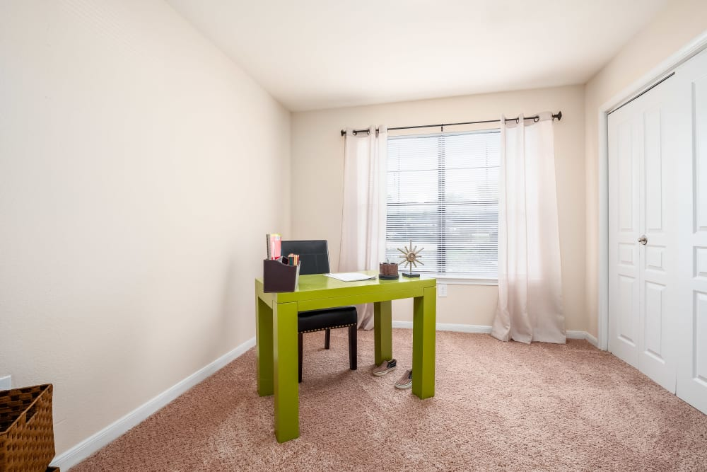 Desk and chair and welded bedroom space at Arbrook Park Apartment Homes in Arlington, Texas