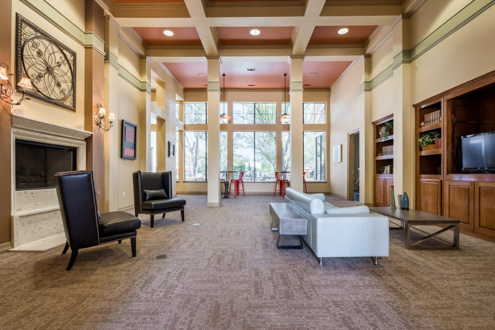High ceiling to clubhouse with community sitting areas at Arbrook Park Apartment Homes in Arlington, Texas
