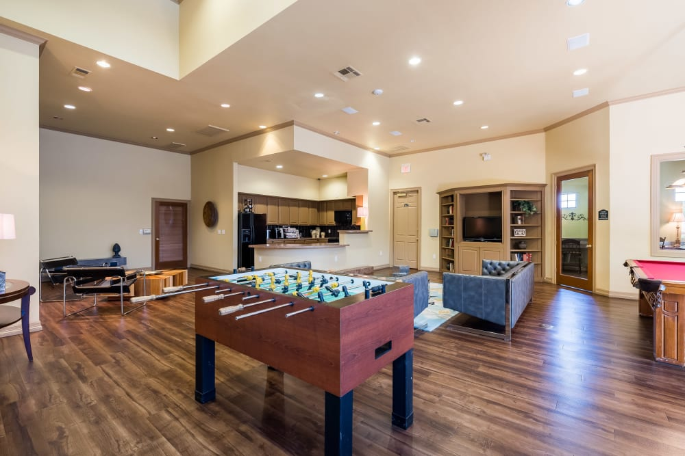 Community clubhouse features foosball and other games at Arbrook Park Apartment Homes in Arlington, Texas