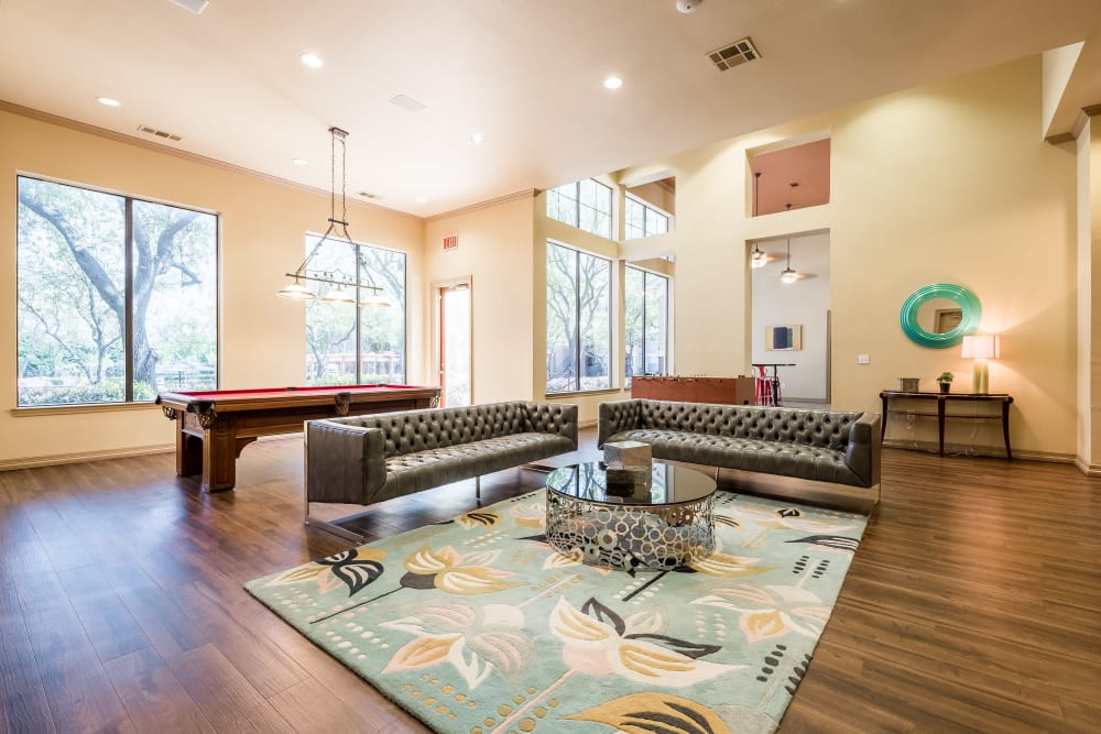 Large open format floor plan in the clubhouse offers lots of community gathering spaces at Arbrook Park Apartment Homes in Arlington, Texas