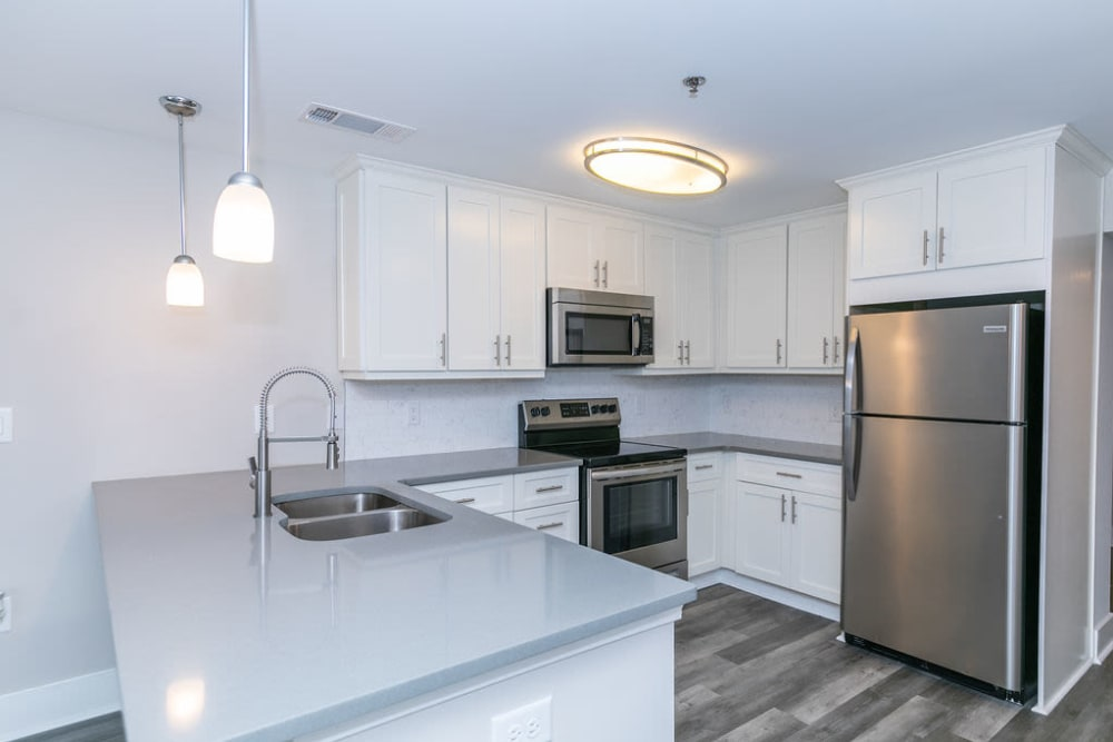 A beautiful kitchen with brand new appliances at The BelAire Apartment Homes in Marietta, Georgia