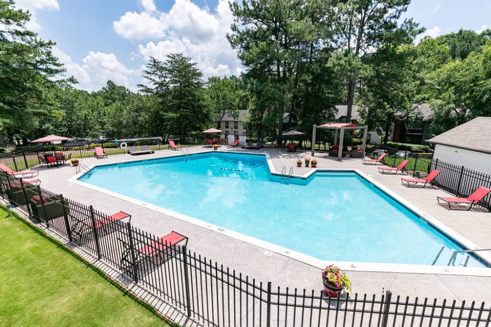 A large pool with fence at The BelAire Apartment Homes in Marietta, Georgia