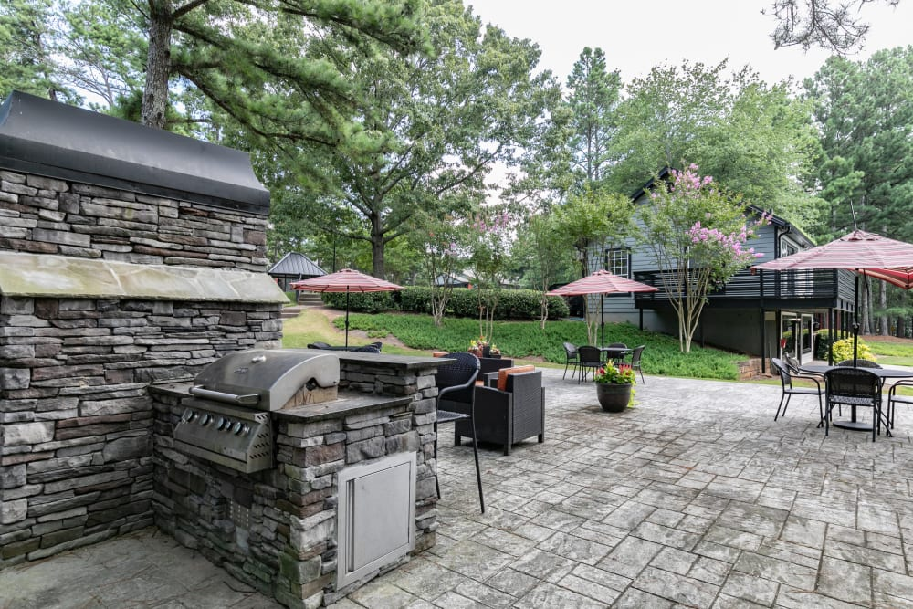 An outdoor firepit and seating area at The BelAire Apartment Homes in Marietta, Georgia