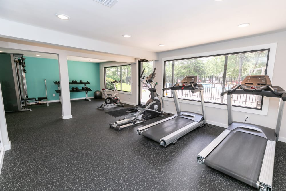 A gym with treadmills at The BelAire Apartment Homes in Marietta, Georgia