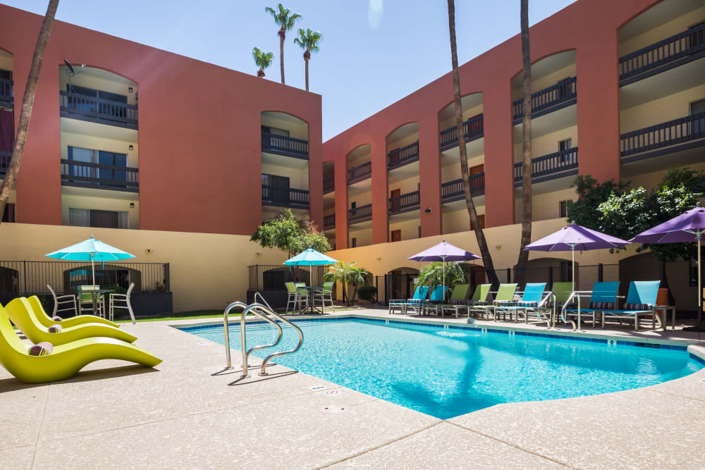 Luxury swimming pool with apartment building in background at 4127 Arcadia in Phoenix, Arizona