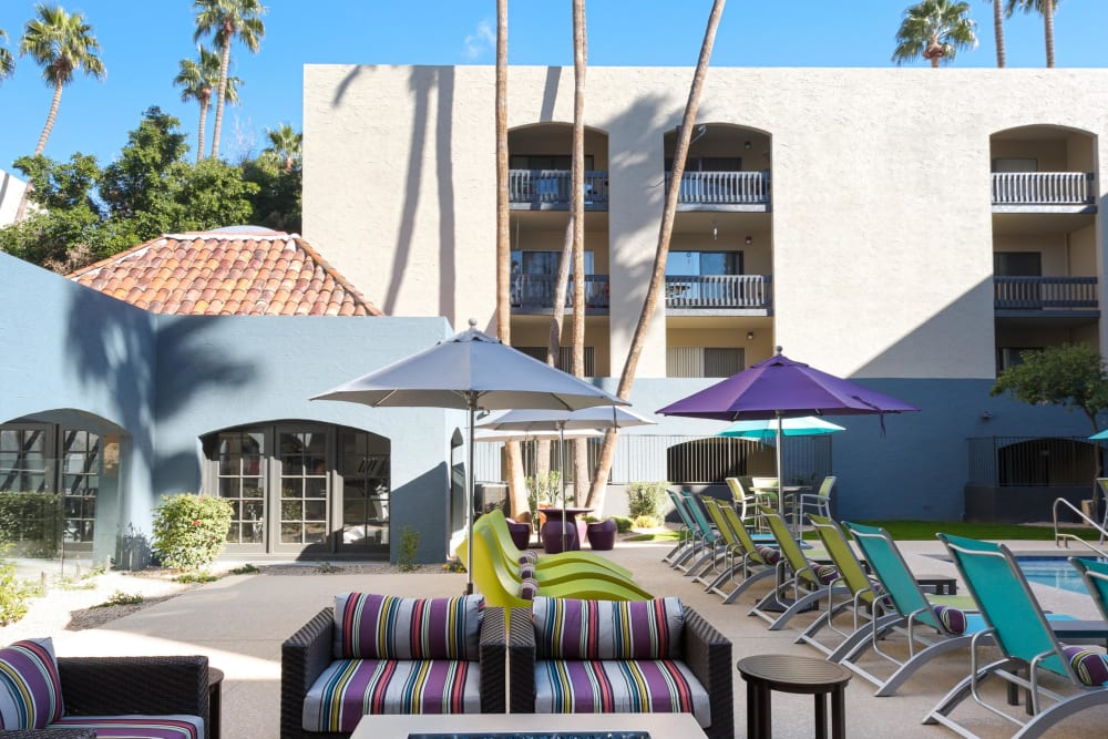 Poolside lounge chairs and a couch she did by large umbrella at 4127 Arcadia in Phoenix, Arizona