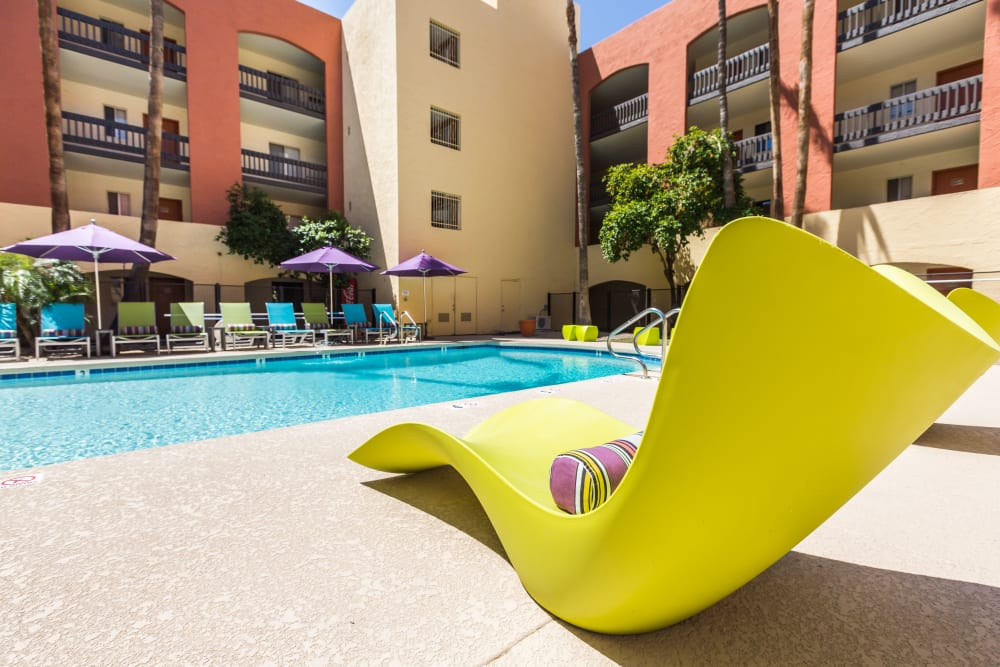 Modern design aesthetic is a feature of the poolside loungers at 4127 Arcadia in Phoenix, Arizona