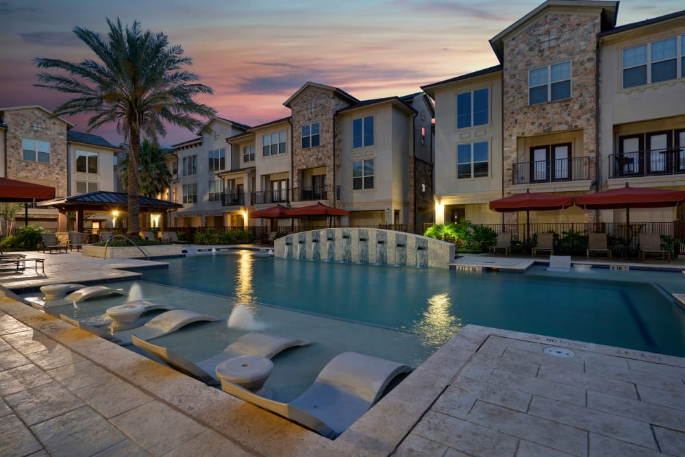 A beautiful image of the pool at night at Arrabella in Houston, Texas