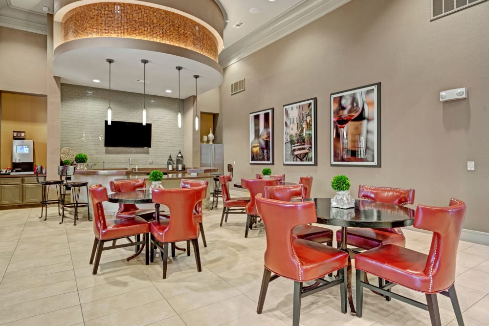 Red chairs with tables in luxurious Clubhouse located at Arrabella in Houston, Texas