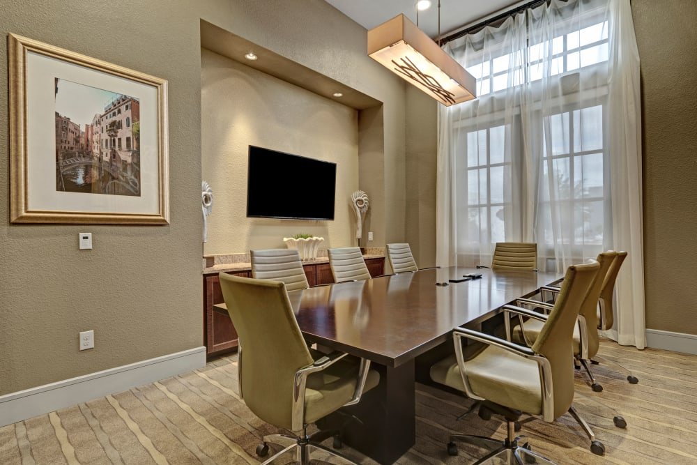 Large table in conference room with French doors leading outside at Arrabella in Houston, Texas