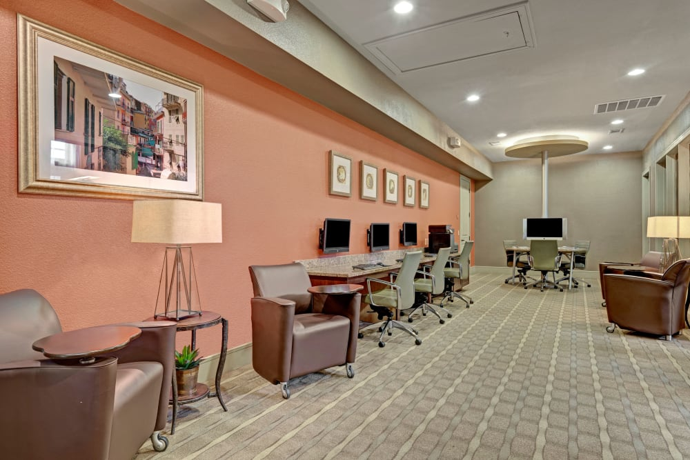 Community space featuring sitting areas and tall ceilings at Arrabella in Houston, Texas