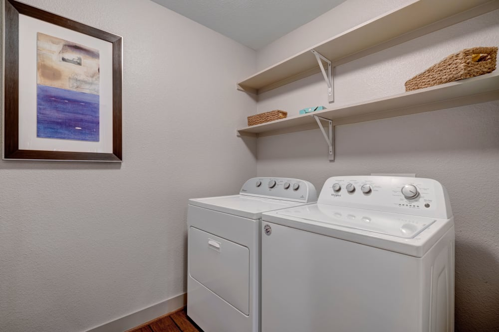 The washer dryer with ample shelf storage in an apartment at Arrabella in Houston, Texas