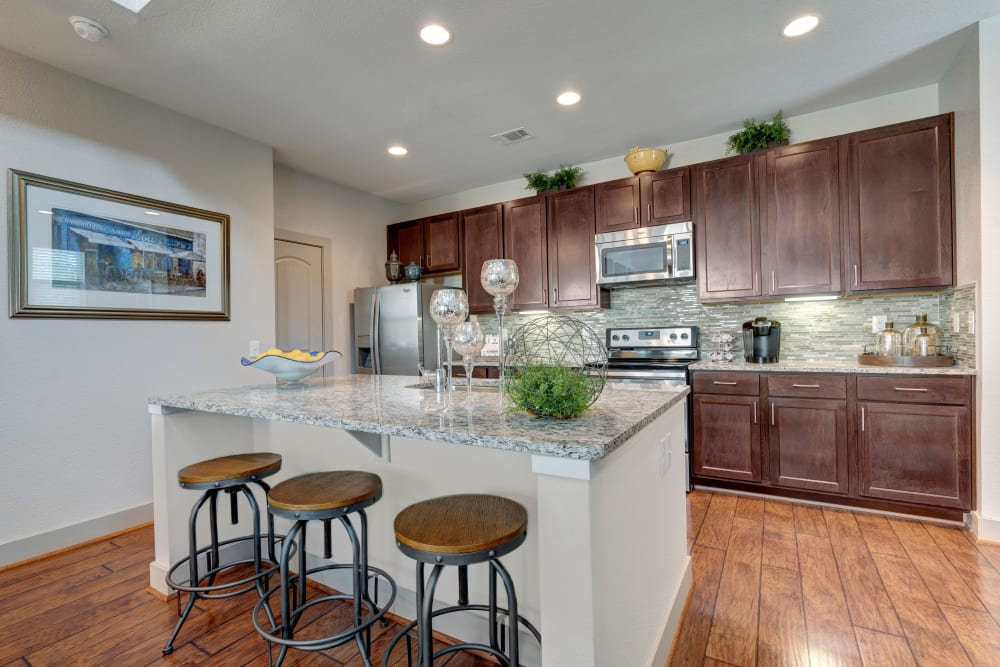 A breakfast bar is featured in this well appointed modern kitchen at Arrabella in Houston, Texas