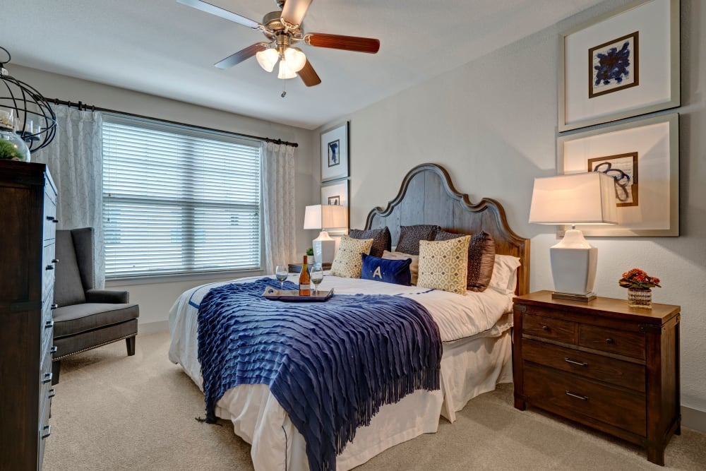 Well decorated bedroom with large window for natural light at Arrabella in Houston, Texas
