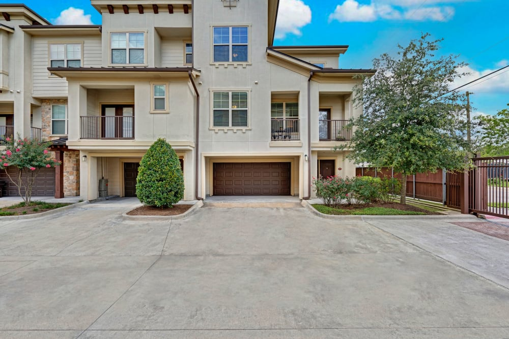 Exterior image of an apartment featuring a garage at Arrabella in Houston, Texas