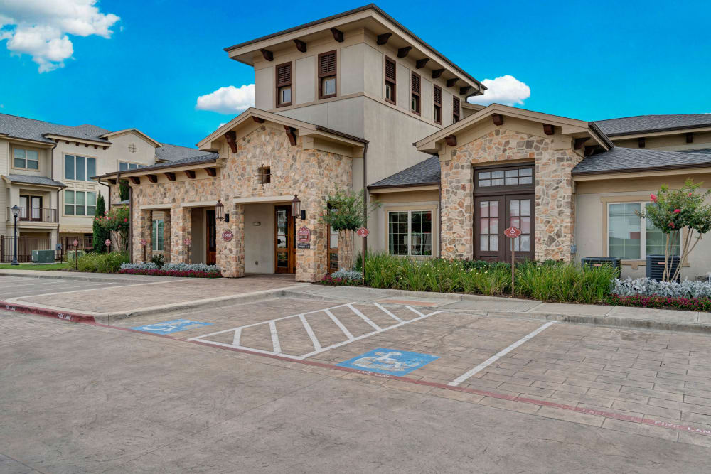 Leasing office and clubhouse as well as parking area at Arrabella in Houston, Texas