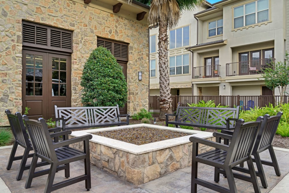 Outdoor fire pit seating near pool area at Arrabella in Houston, Texas