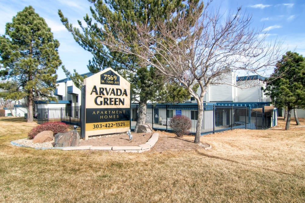 Community sign and leasing office at Arvada Green Apartment Homes in Arvada, Colorado