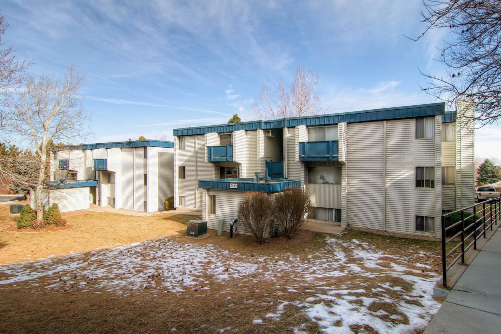 Exterior image of apartments and community green space at Arvada Green Apartment Homes in Arvada, Colorado